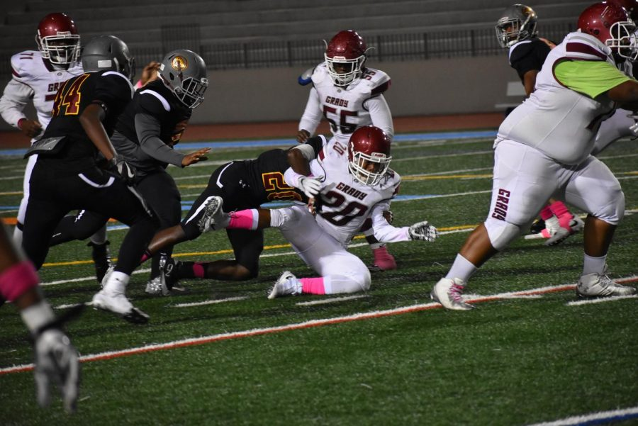 Grady senior running back Barry Wright fumbles the ball toward the end of the first half. The Knights fell 27-6.