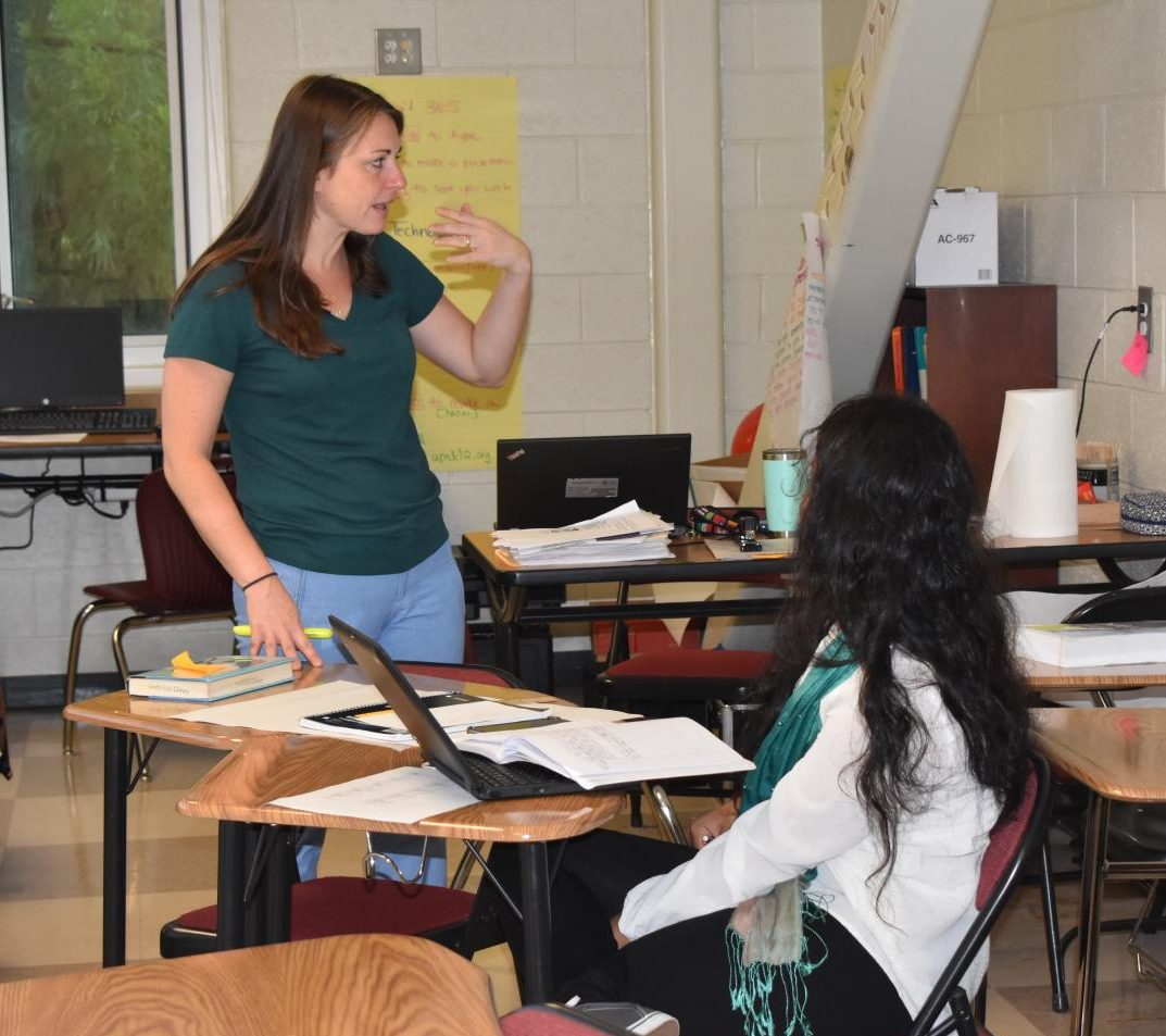 A TEACHING MOMENT: ESOL teacher Katherina Maryska explains a concept to senior Sabiha Akter. Akter is from Bangladesh where the official language is Bengali. Maryska uses body language to aid in learning.
