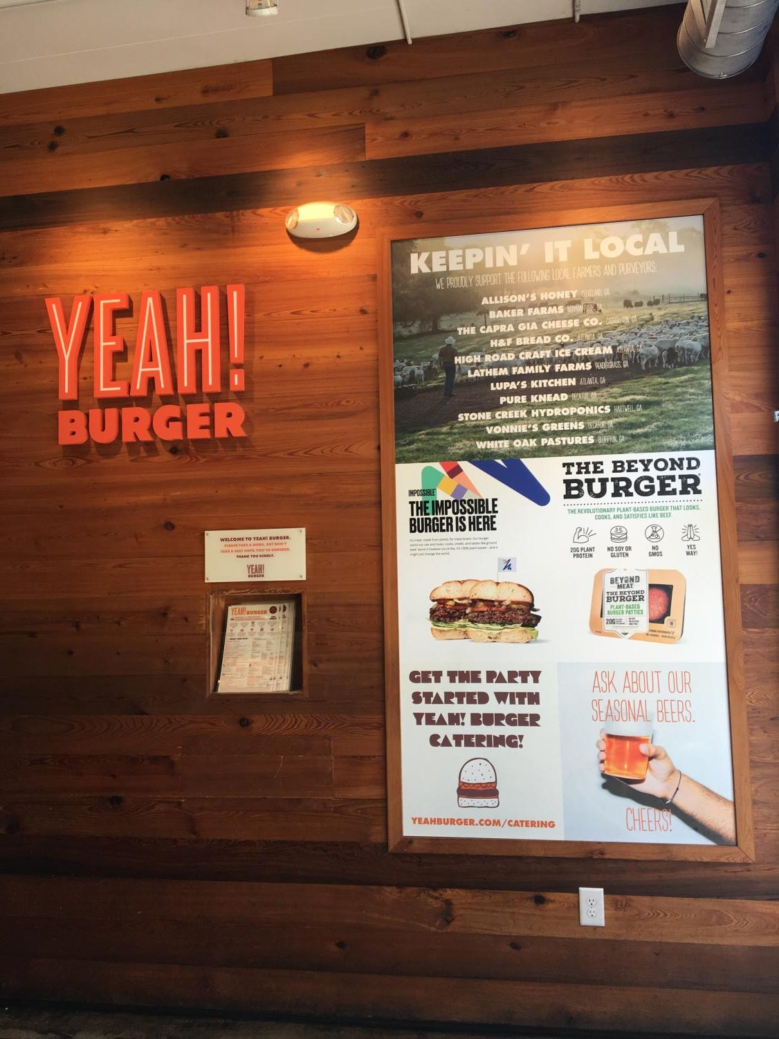 Walking through the front doors of Yeah! Burger in the Virginia Highlands, a poster advertising the Impossible Burger broadcasts its existence on the menu.