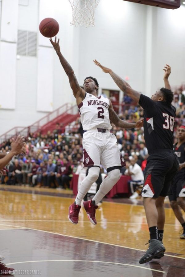 UNFINISHED BUSINESS: 2014 Grady alum and former Morehouse point guard Tyrius Walker #2 goes up hard in the paint for a layup.