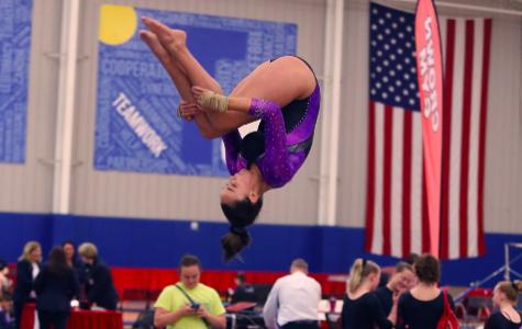 Sophomore Madigan Duncan flips off of the balance beam performing her dismount.