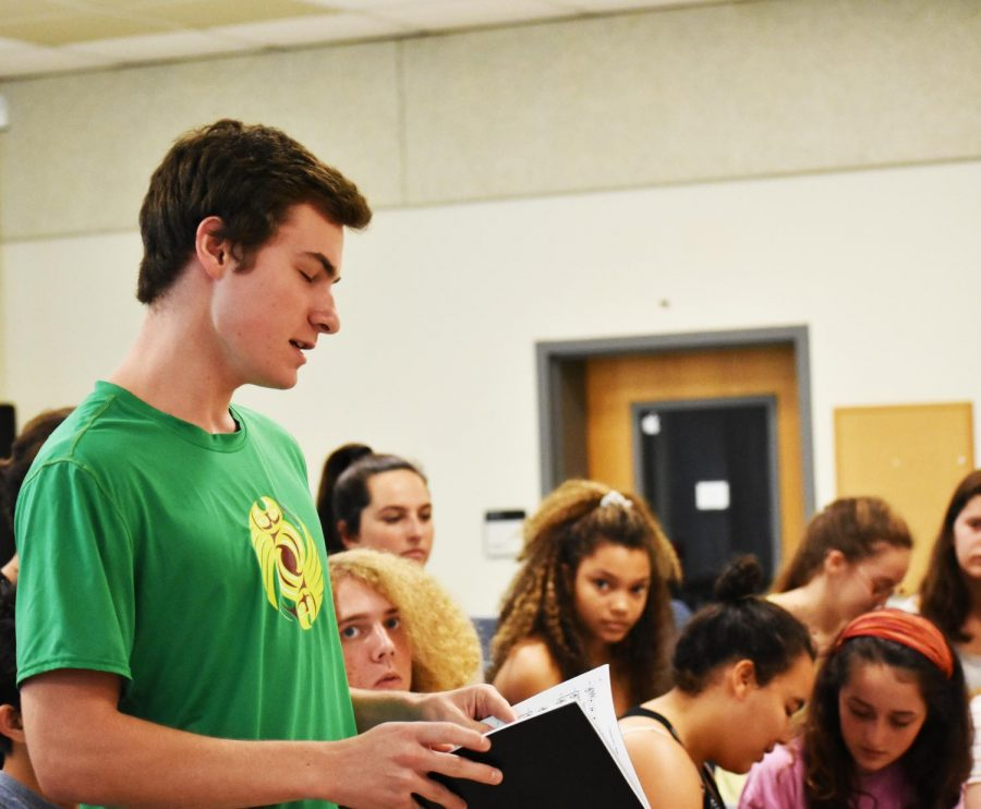 Senior Robert Mobley practices his solo performance as Bobby Mills.