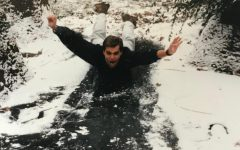 Nicolai Curtis slides across a frozen pond at the Knoxville Zoo in Knoxville, TN where interned as a zoo keeper during college.