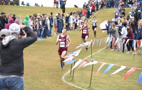 Juniors Bram Mansbach and Kavi Jakes run through the shoot into the finish in Carrollton. Mansbach placed 20th and Jakes finished 21st.