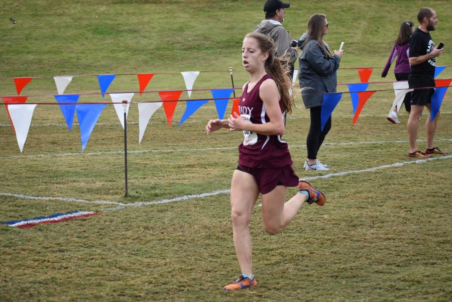 Senior+Anna+Tischer+runs+through+the+shoot+into+the+finish+at+the+state+course+in+Carrollton.+She+placed+second+for+Grady+and+25th+overall+with+a+time+of+21%3A16.59.+This+was+Tischer%27s+fourth+and+final+state+meet+of+her+high+school+career.