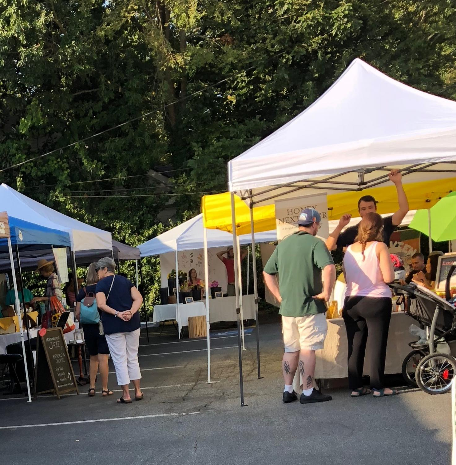 Shoppers browse for organic foods on an early fall morning during the weekly Morningside Farmers Market. The market opens every Saturday at 8 a.m.