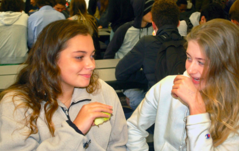 Sophomores Lindsey Snyder (left) and Carson Gray giggle over small talk at lunch.
