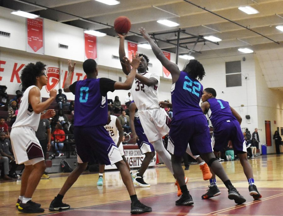Junior Dewan Wright shoots the ball surrounded by Hornets on Nov. 13. Wright is a 65 powerhouse.