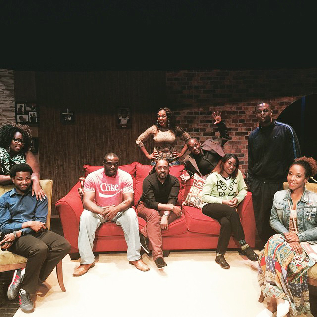 """Math teacher Jermaine Ross relaxes with the cast at the set of his play, """"Slum Beautiful."""" Ross gave a reading of the play at Grady in the 2013-2014 school year, which was his second year of teaching."""