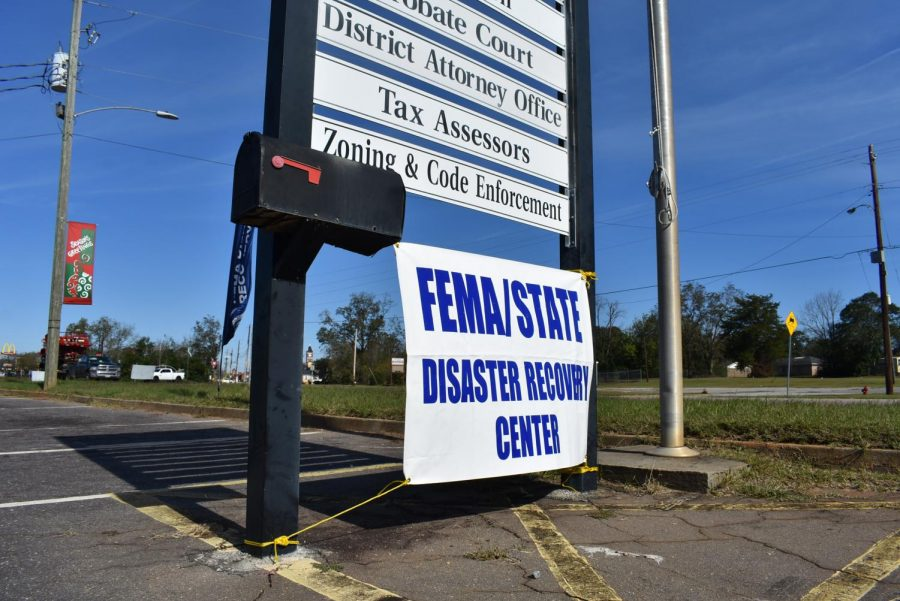 """FEMA: A Federal Emergency Management Agency (FEMA) sign hangs in front of the Terrell County Courthouse in Dawson, Georgia. FEMA offers assistance to communities and first responders after major disasters. Their mission statement is """"Helping people before, during, and after disasters."""""""