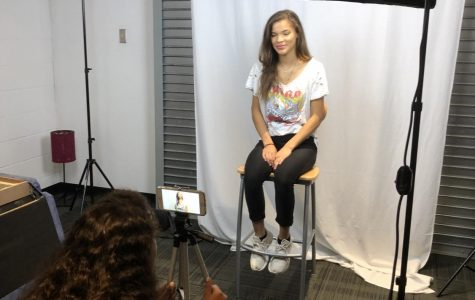 Lights, camera, action: Smith films an interview with Hailey McLeod for her documentary,
