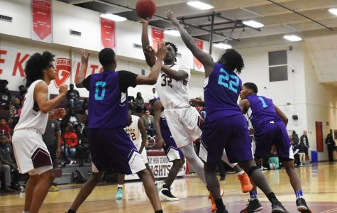 HARD IN THE PAINT: Junior Dewan Wright shoots the ball surrounded  by the South Atlanta Hornets on Nov. 13. This is Wright's second year on varsity. He is a 6'5 powerhouse.