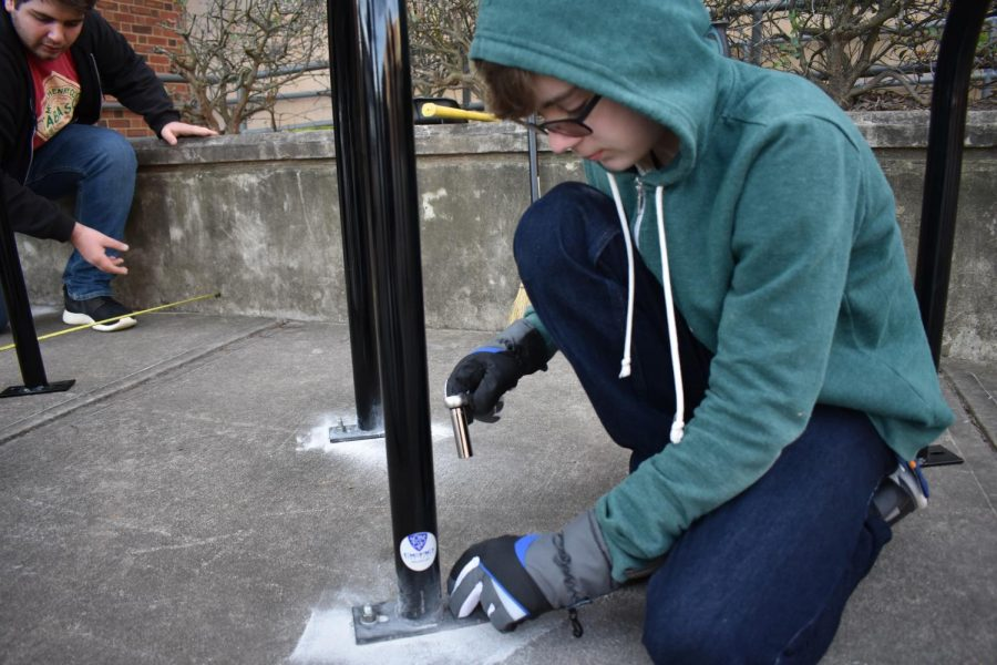 On Monday, January 14, 7 students installed bike racks, and initiative led by junior Bria Brown. Pictured is sophomore Henry Gelber screwing in the racks in 30 degree weather.