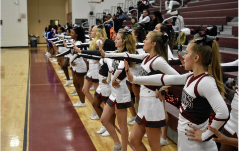 The cheerleaders cheer on he boys basketball team  in the a scrimmage game against South Atlanta on Nov. 13. The cheerleaders are required to attend every game.