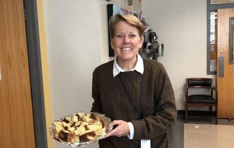 BOCKMAN BAKING: Principal Dr. Betsy Bockman stands with freshly baked pound cake. Dr. Bockman brings in treats twice a week.