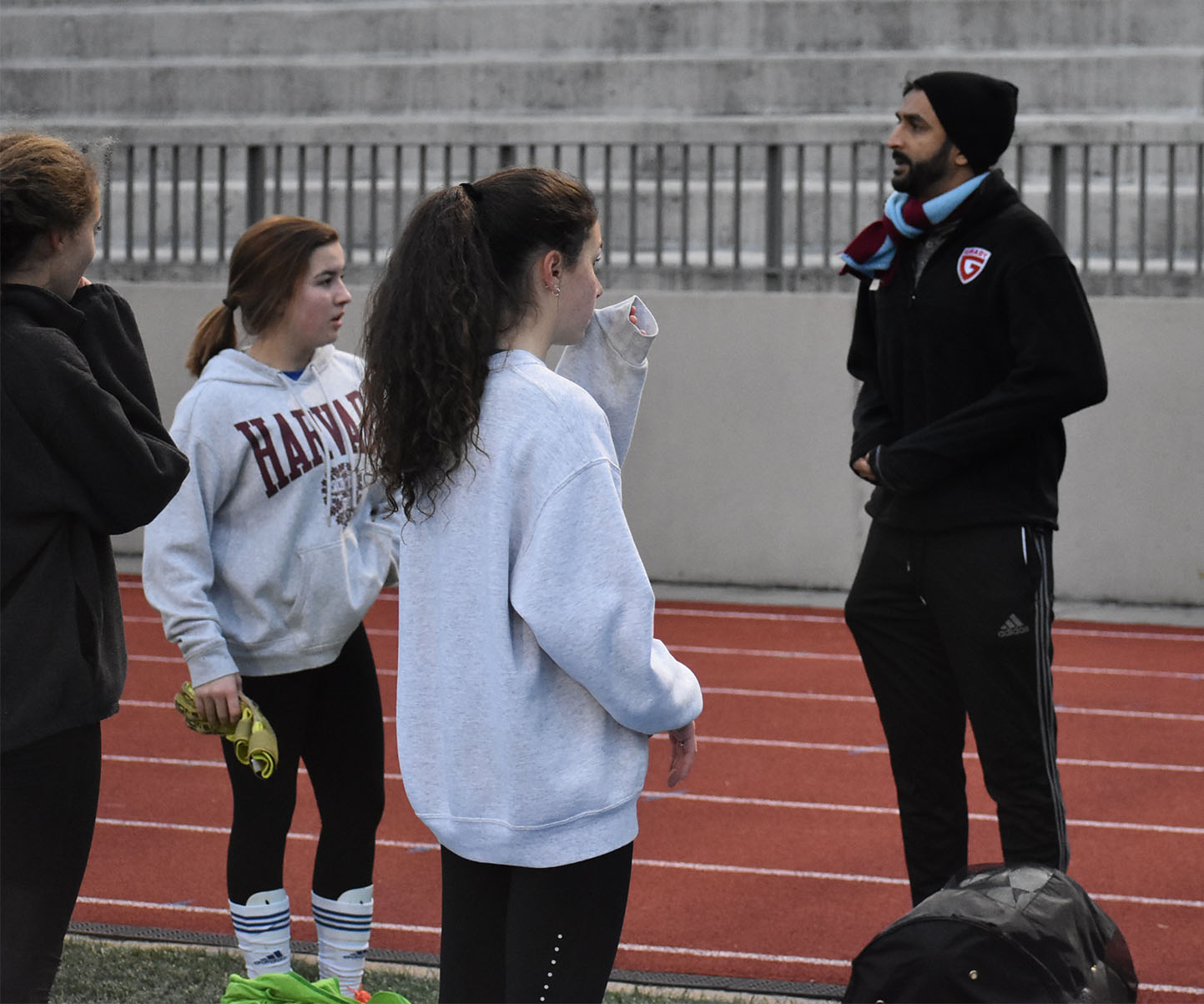 SOCCER SEASON: Member of the Junior Varsity Girls soccer team prepares for the upcoming season by talking to coach Hamel Patel. This new JV team offers freshmen a place to hone their skills as they prepare to play varsity in their coming years.