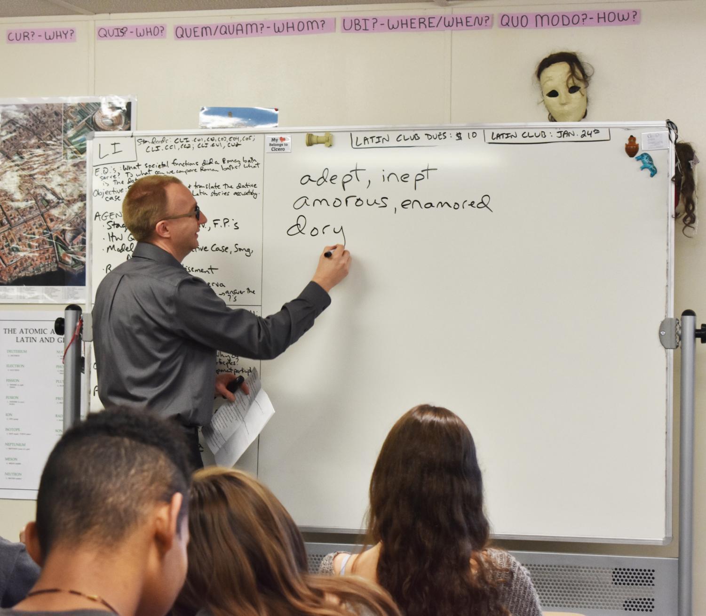 Latin teacher Scott Allen teaches derivatives to Latin II students.