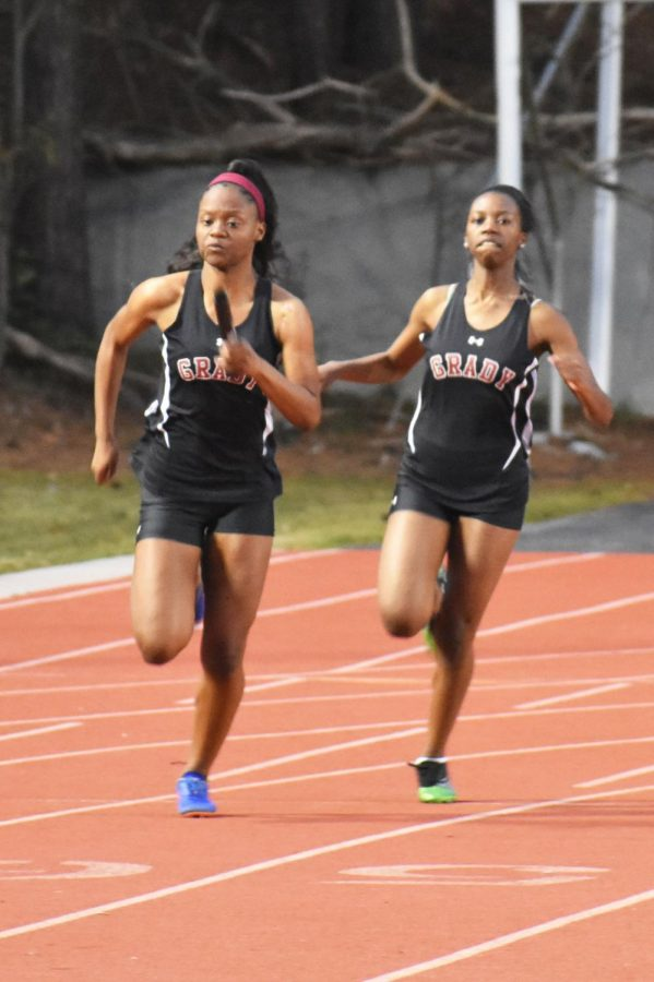 Sophomore+and+captain+Ameah+Richardson+receives+the+baton+from+sophomore+Kendall+Jones+in+the+4x100m+relay++at+the+Grady+Opener+on+Feb.+26.+%E2%80%9CIt+felt+really+good+to+be+named+captain+this+year%2C+and+I+really+hope+that+I+can+meet+the+expectations+of+the+team+and+bring+us+together+more+as+a+family+than+a+team%2C%E2%80%9D+Richardson+said.