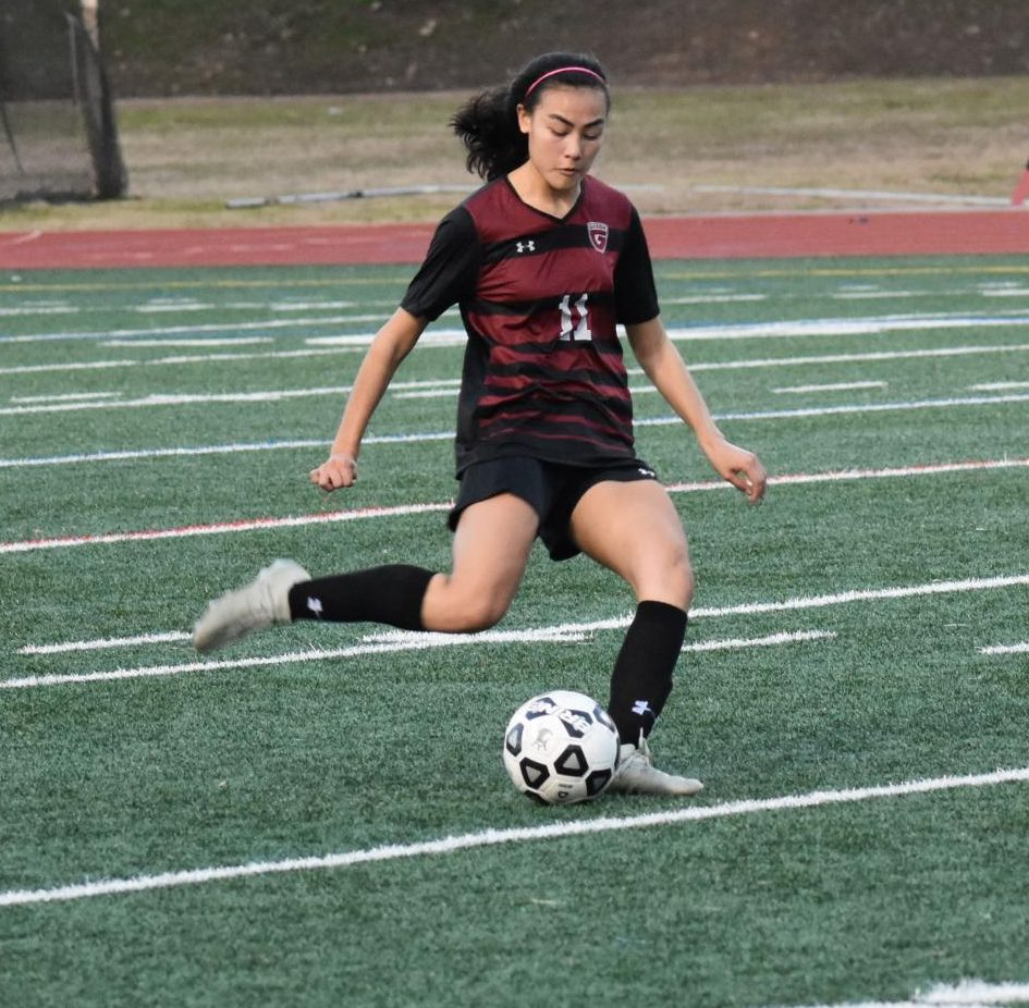Mia Wood, who is now playing college soccer, takes a free kick in a game against North Atlanta last season. Soccer tryouts started Jan. 13 for this season.