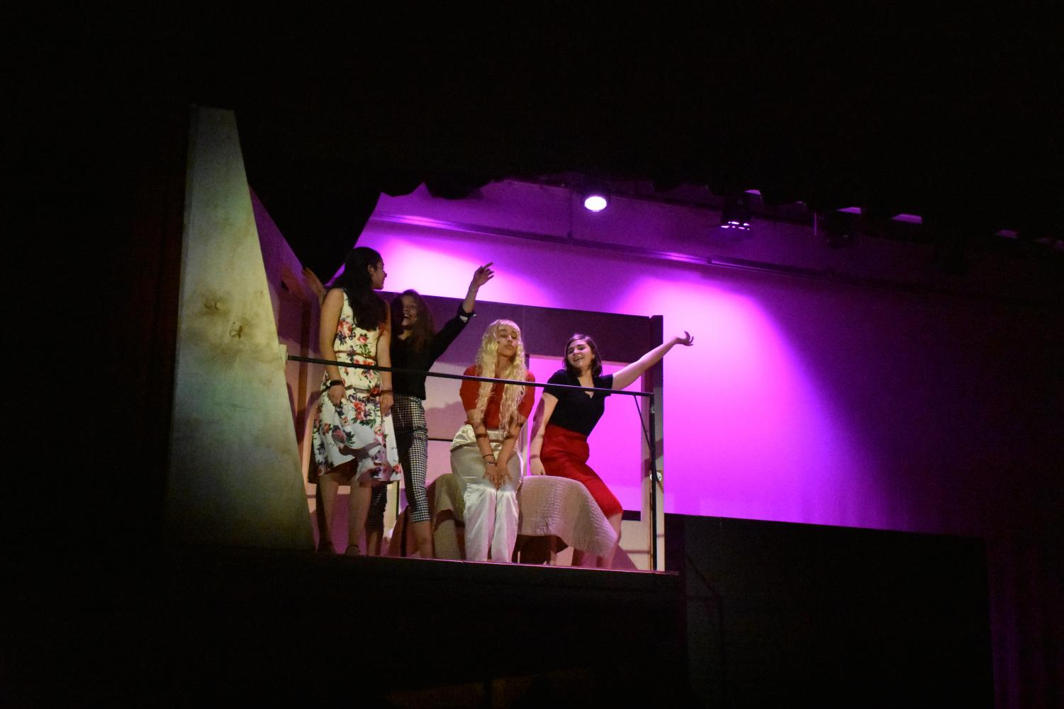 (From left to right) Theater students Emilia Gustafson, Nadia McGlynn, Paris Whitney and Maddie Thorpe rehearse the song