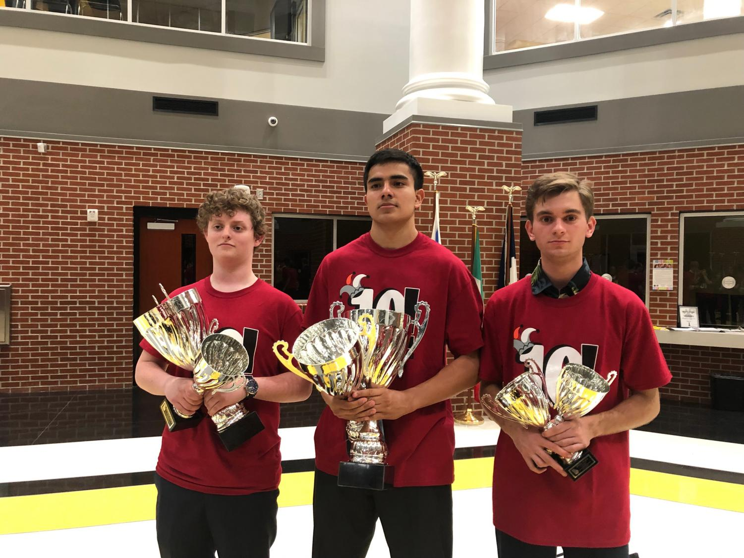 Seniors Harrison Gray, Franky Fernandez and Eric Slovensky pose with serious faces and trophies in hand at the State competition in Valdosta, GA.