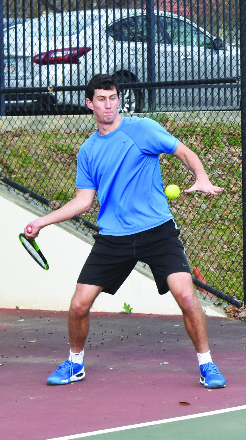 NOT YOUR AVERAGE WOLFE: Senior Josh Wolfe strikes a forehand during tennis practice on Feb. 23. He is signed to attend Lafayette College next fall to play tennis.