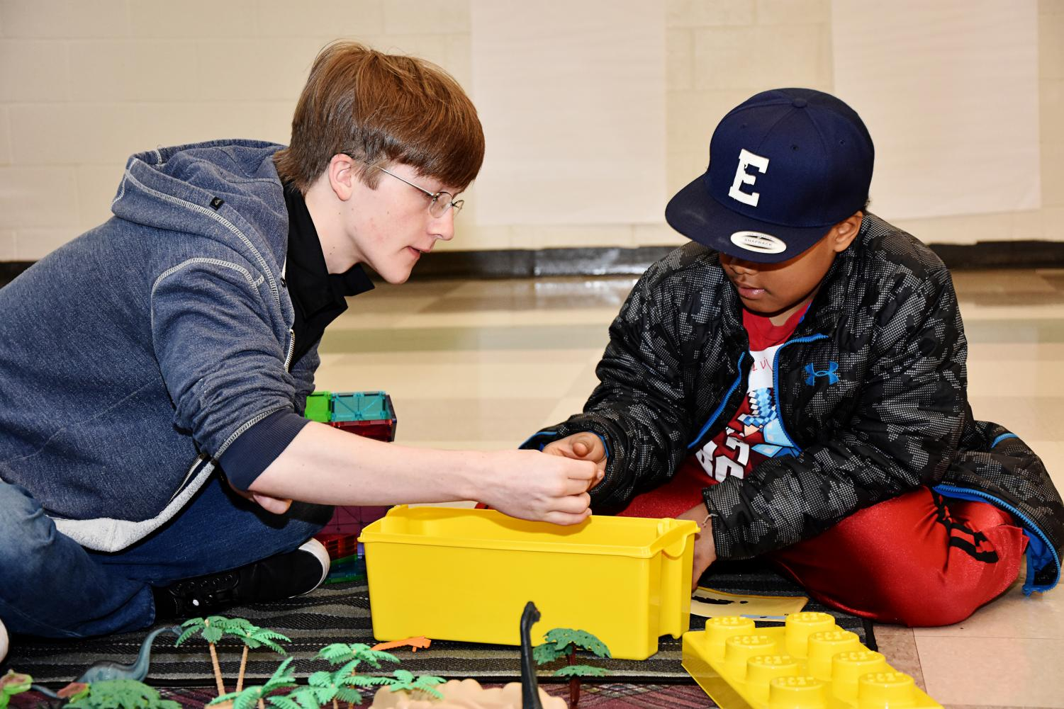 Senior Crispin Gambill works with special needs student at MDE school on Sept. 15.