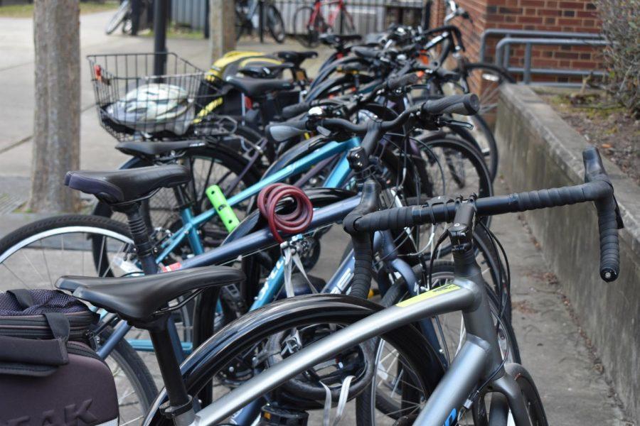 Several bikes crowd the racks near the courtyard.