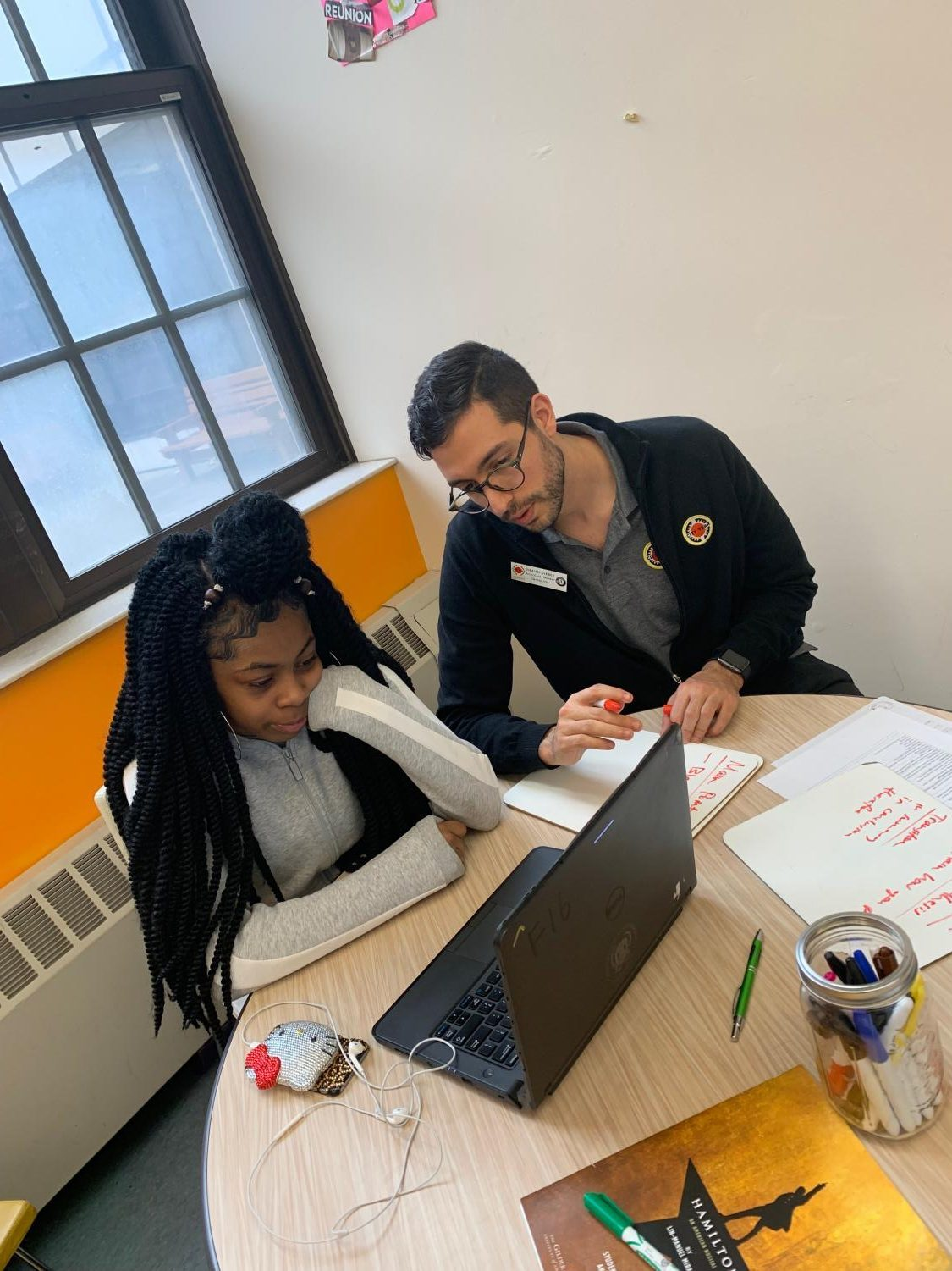 STRIVE FOR SUCCESS: Grady alum Shaun Kleber works with one of his students in Detroit for City Year. Kleber hopes to use this to jump-start his career into education.