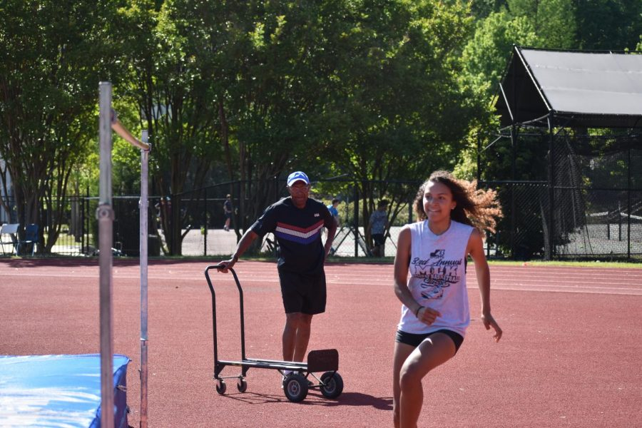 Quinaliza coaches jumping, including the high jump, triple jump and long jump, for the track & field team.