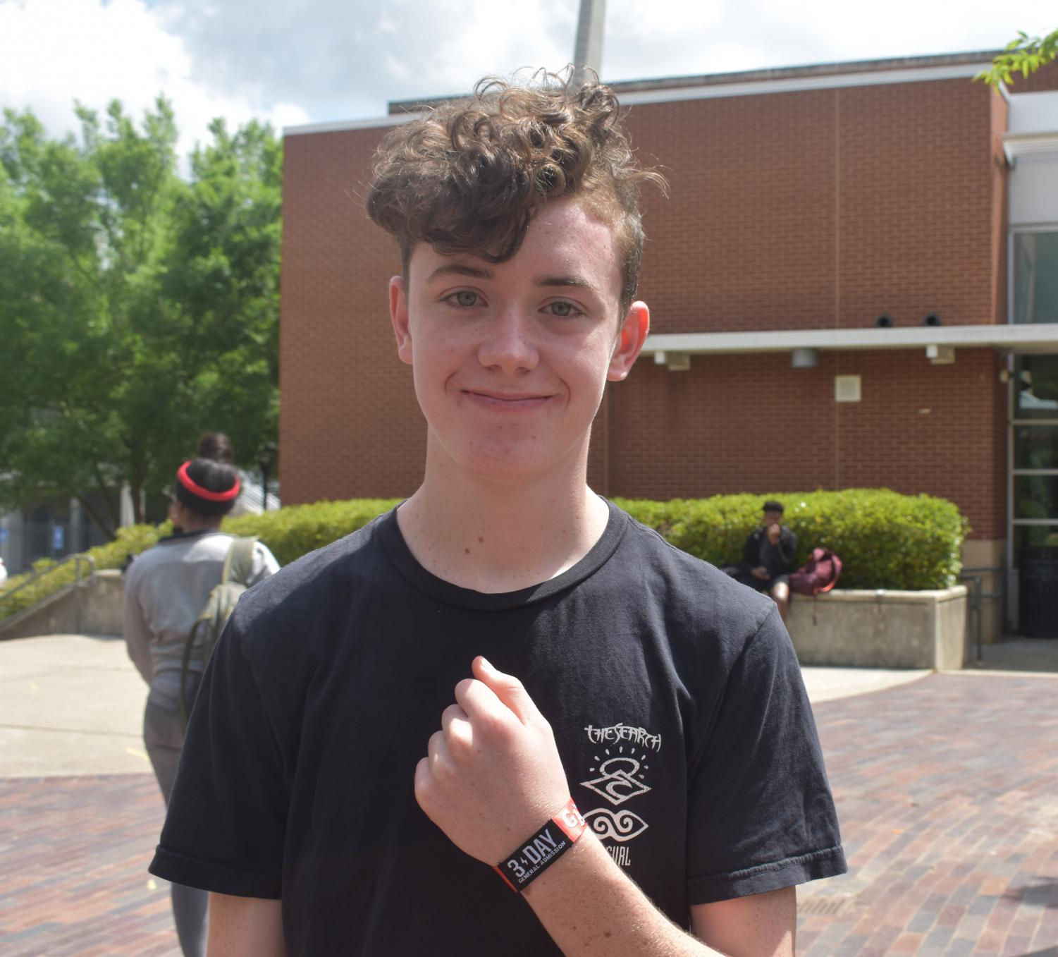 Sophomore Brody Dowling shows off his Shaky Knees music festival wristband. Shaky Knees is May 3-5 at Central Park in Atlanta.