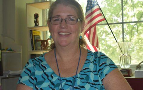 Grady social studies teacher of 26 years, Mary Van Atta, smiles as she sit in her classroom.