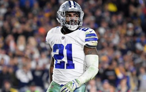 Dallas Cowboys running back Ezekiel Elliott held out before the start of the NFL season for a larger contract.