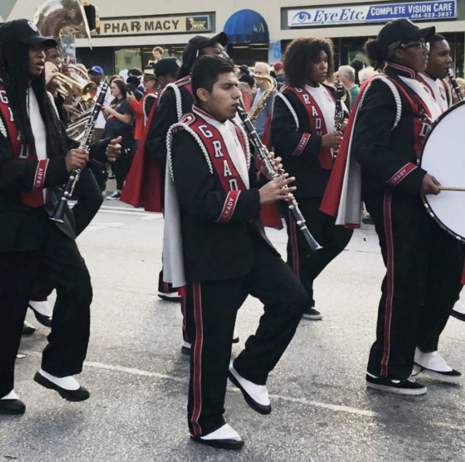 Grady marching band performs in the Little 5 Points Halloween Parade on October 20, 2018.