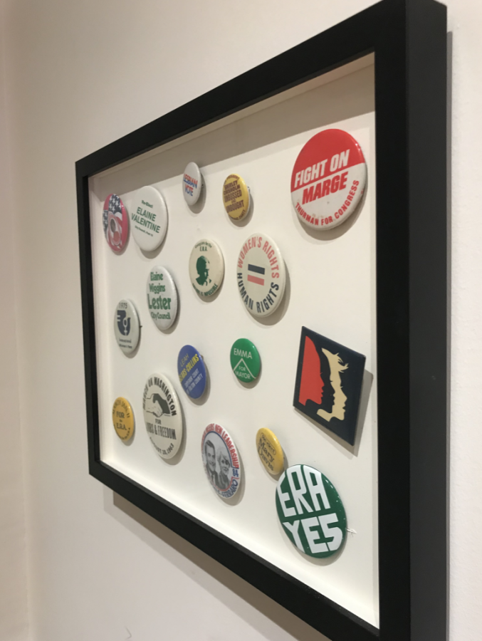 A collection of buttons for women politicians and women's rights are showcased at the Atlanta History Center. The styles and slogans of the buttons show how much progress women have made.