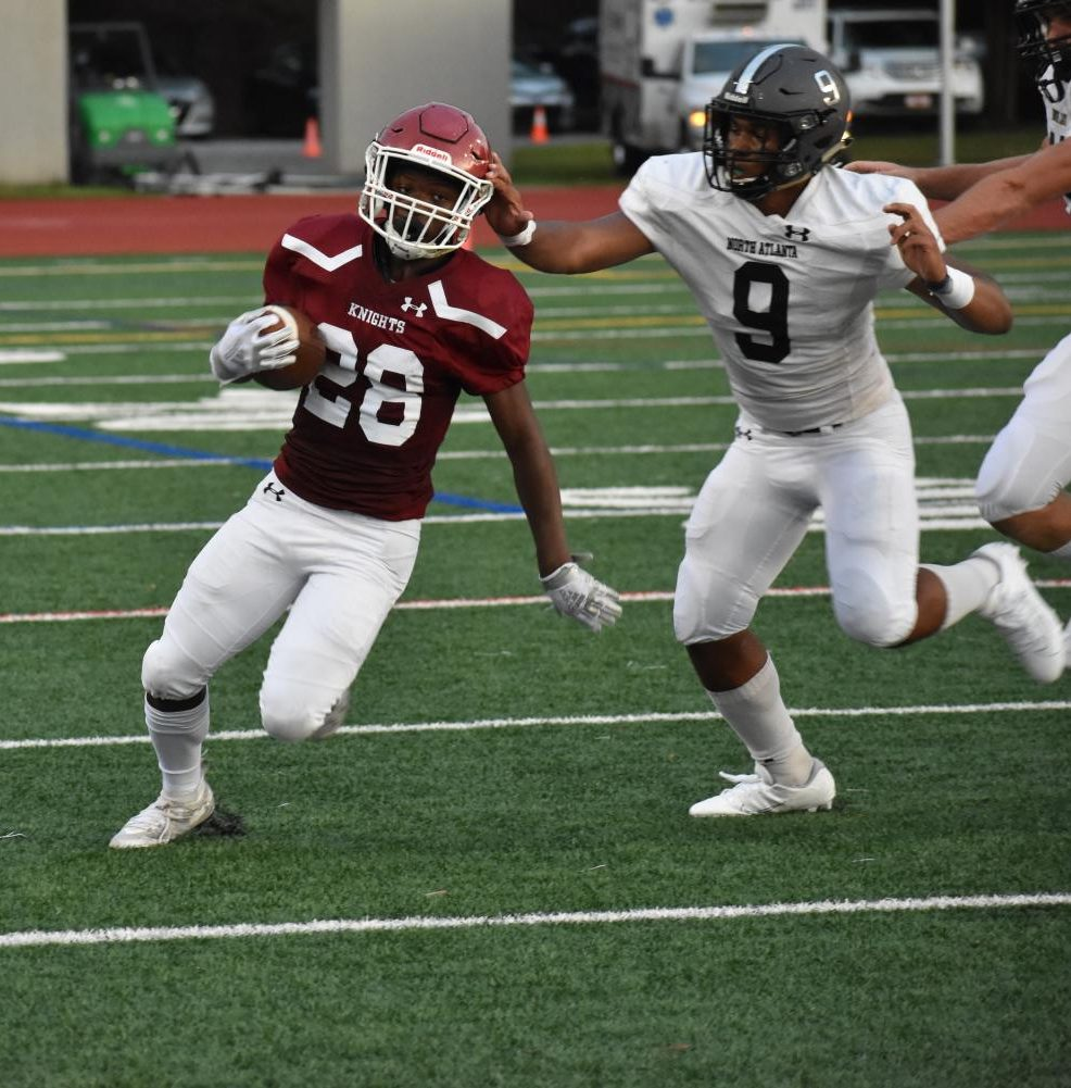 Freshman Jumal Prothro runs from the backfield as he is tracked down by a North Atlanta player. He gained about 6 yards on the play.