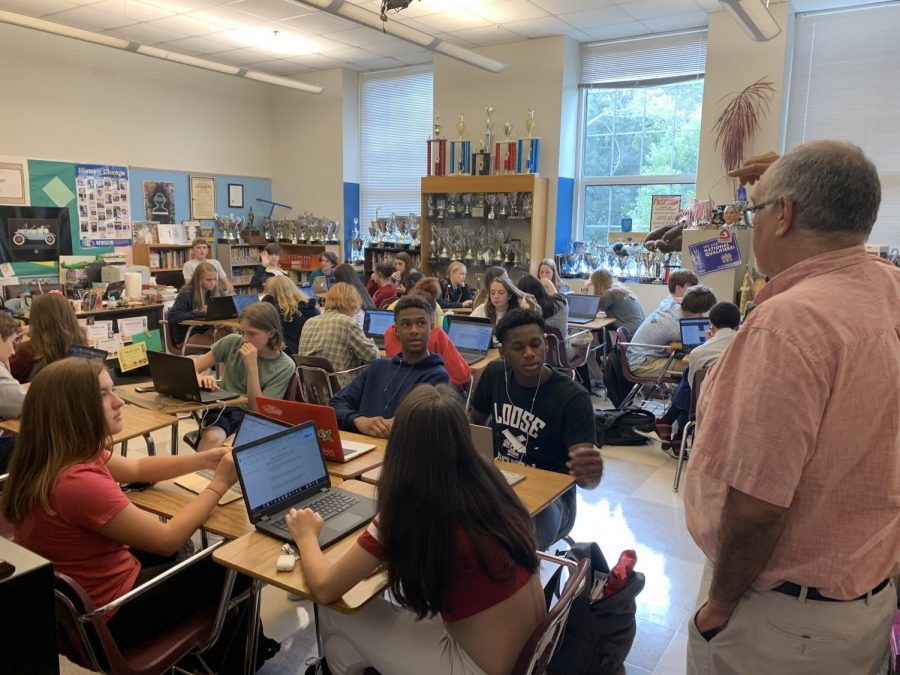 FIRST-CLASS CURRICULUM: AP Seminar teacher Mario Herrera speaks to his class. Herrera led the effort to implement a new AP Seminar curriculum at Grady.