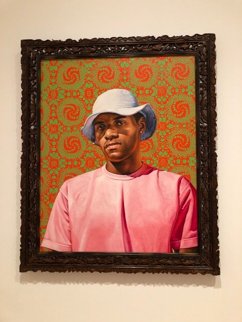 Thiogo Gliveira do Rosario Rozendo by Kehinde Wiley hangs in the High Museum of Arts contemporary collection. It is one of the paintings in Liviuss tour on social justice.