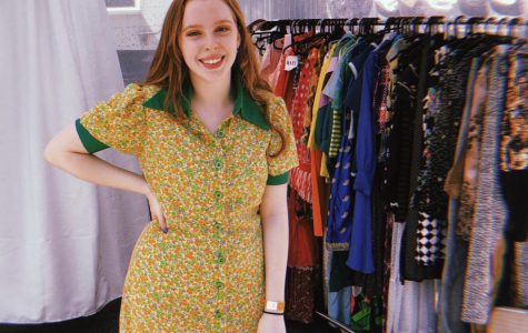 In addition to selling her vintage clothes online, Bella does local popups and festivals. Here, she poses in front of her booth at the Atlanta Fila Fest.