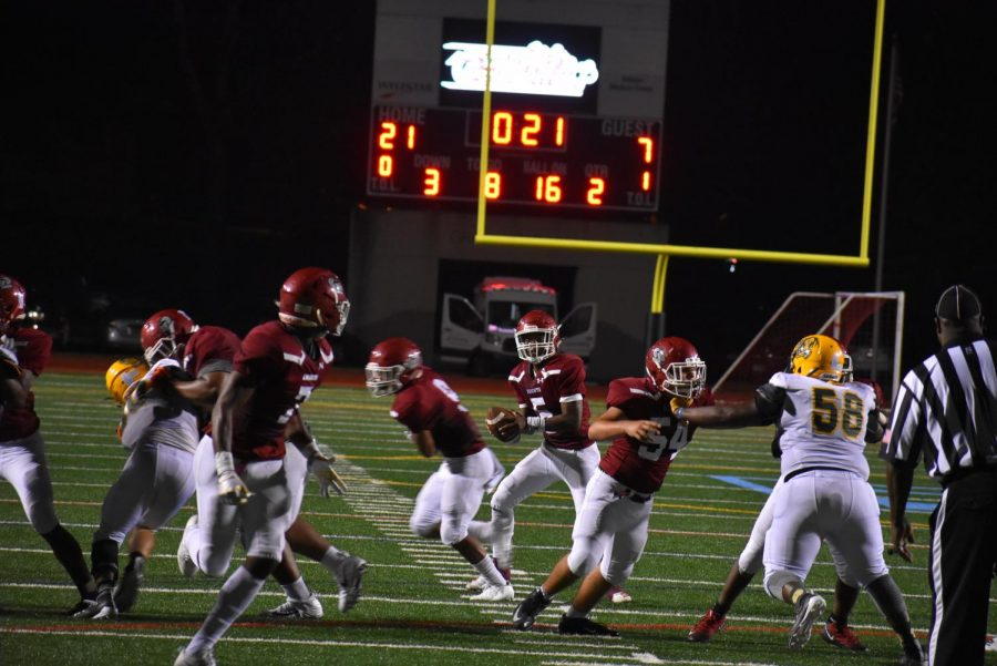 Senior quarterback Aquinas Stillwell looks to find senior tight end Dewan Wright over the middle to extend the Knights lead in the second quarter.