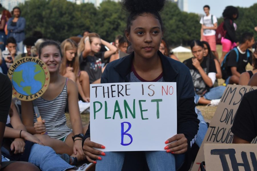 Junior+Amarie+Blackshear%2C+listens+to+a+speech+from+Danielle+Millburn%2C+as+she+holds+a+sign+reading%3A+%22There+is+no+Planet+B.%22+