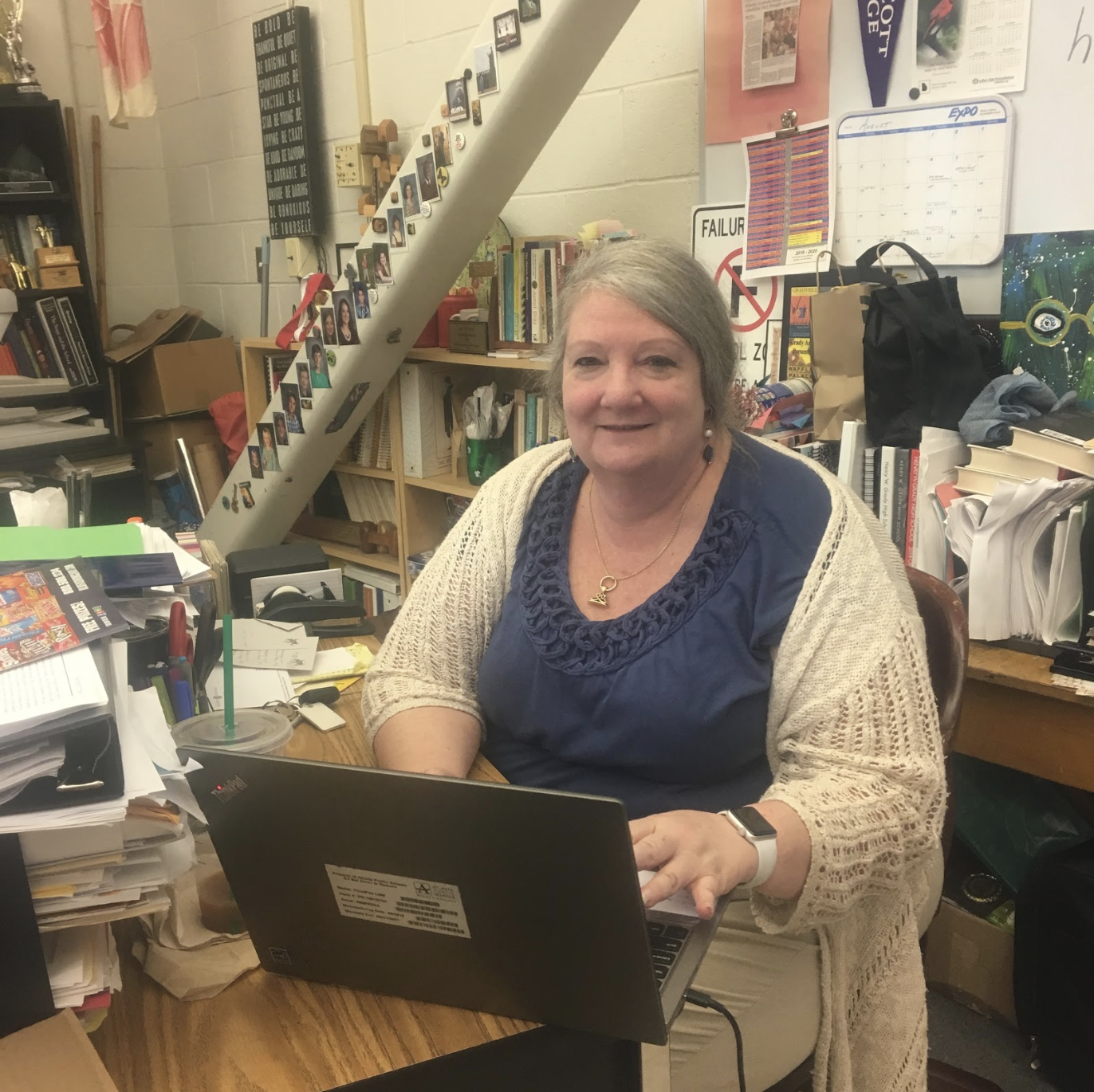 Lisa Willoughby, working during her planning period, in between teaching literature classes.