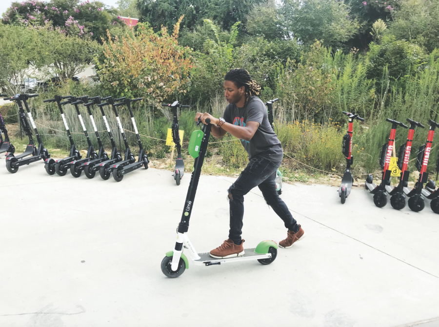 SCOOTING ALONG: Johan Hood, employee at Mint Salon, rides a Lime Scooter on the BeltLine near the intersection of 10th Street  and Charles Allen Drive. E-scooters have become a popular form of transportation in Atlanta since their introduction in 2018. Hood uses the scooters as a form of stress relief.