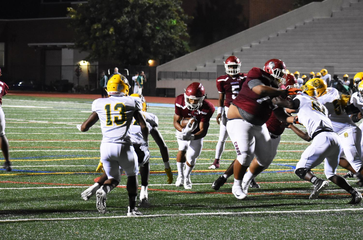 Senior Canaan Brant finds the gap in the offensive line to score a touchdown in the second quarter of the game against Lithia Springs on Sept. 20. The Knights won the game in overtime 45-42.