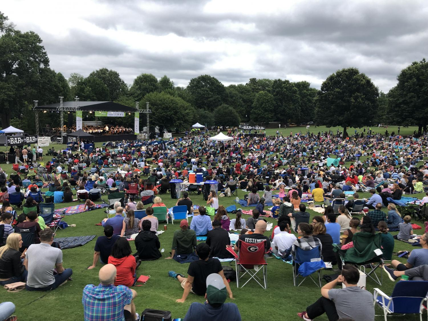 The Atlanta Symphony Orchestra performs on Piedmont Park's Oak Hill while a large crowd of listeners enjoy Tchaikovsky's Fifth Symphony.  Concerts are one of the many PPC sponsored community events that take place at the park throughout the year.