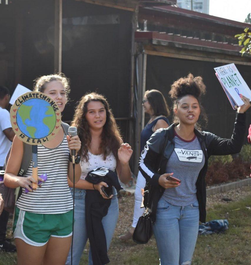 Seniors Mia Prausnitz-Weinbaum, Jordan Tucker and junior Amarie Blackshear lead a chant at the Grady Walk Out on Friday, Sept. 27, 2019.