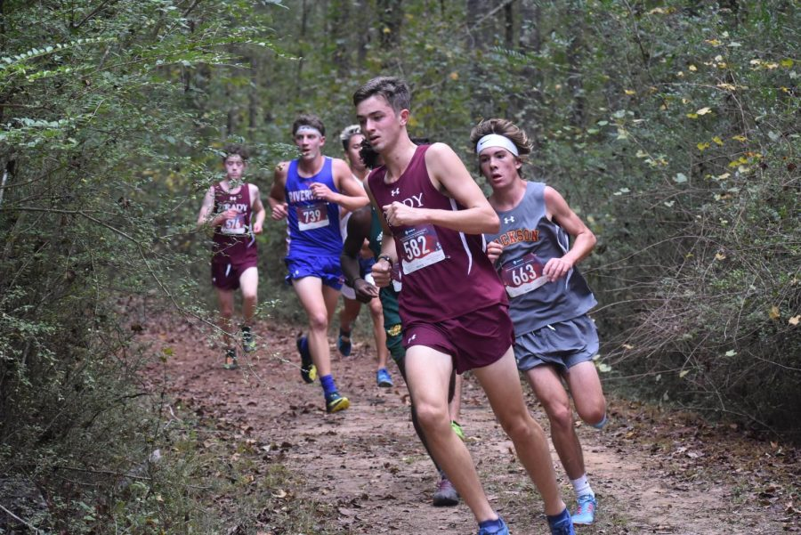 Palaian rounds the corner, followed by Dowling, after the first mile of the race.