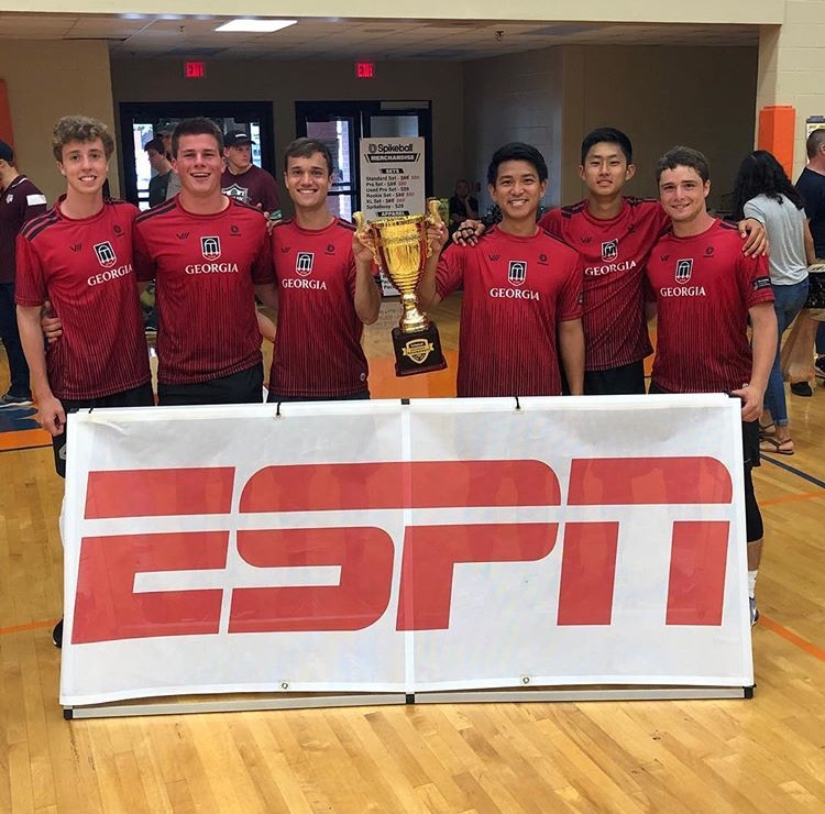 Randal Wins: Tyler Randall with his championship winning Spikeball team, holding up the trophy after securing first place in the national college Spikeball tournament