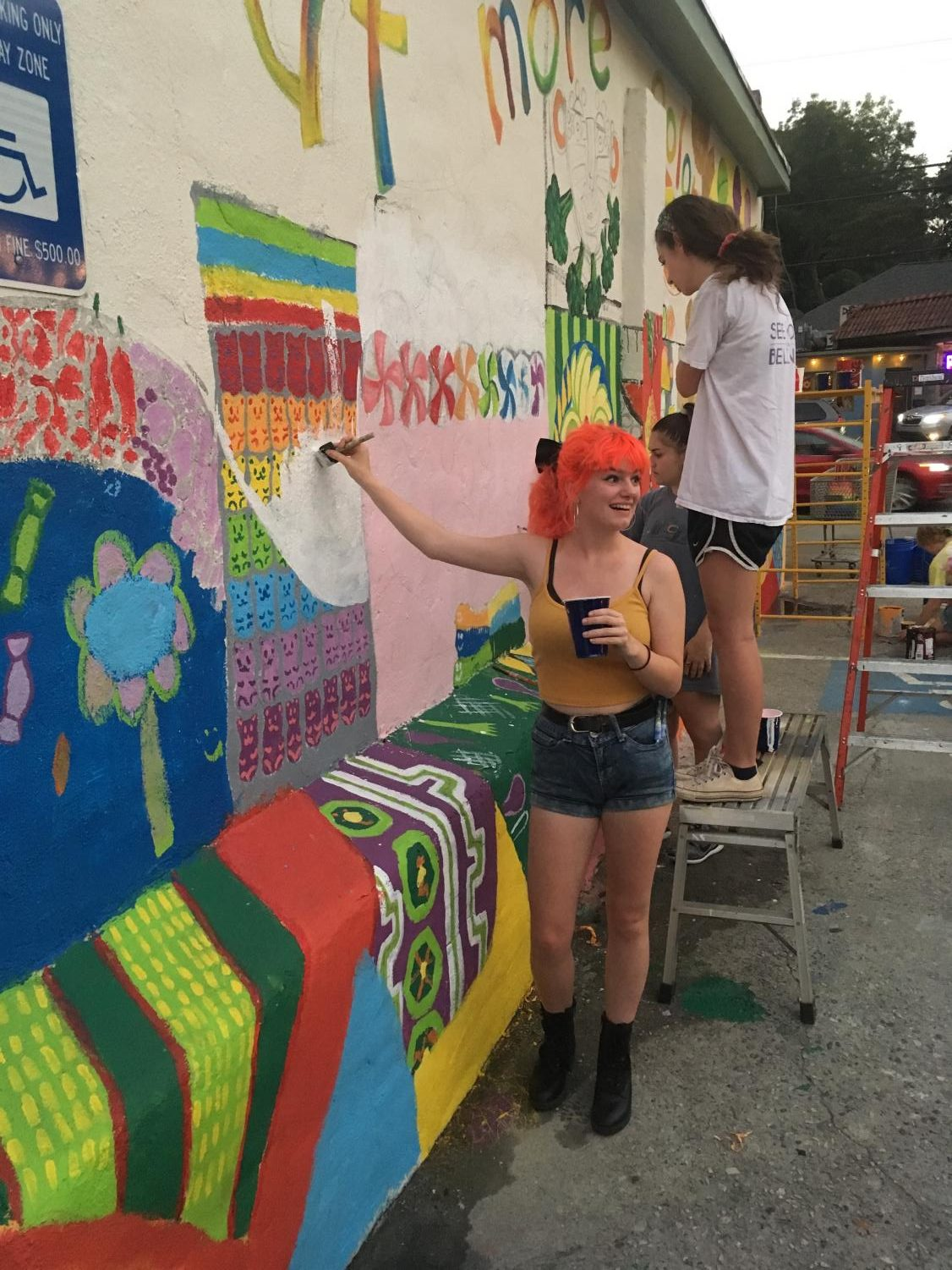 AP Art student Rose Nichols works on a mural at the Candler Park Market. The National Art Honor Society promotes opportunities such as these.