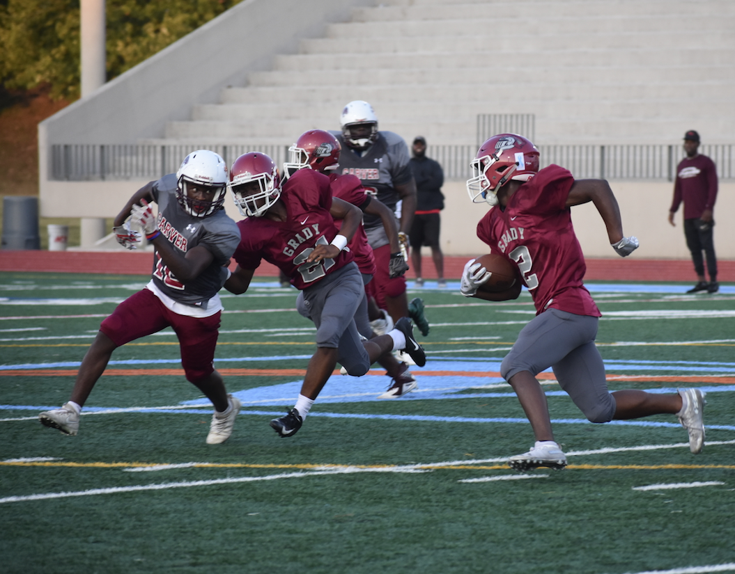Freshman Jumal Prothro runs from a Carver defender in an attempt to score a touchdown for Grady.